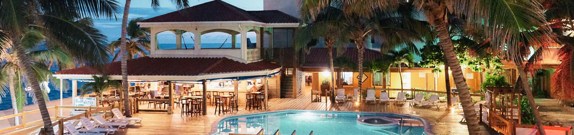 Sunbreeze Hotel at dusk Pool Bar & Restaurant
